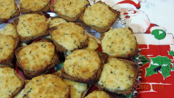 Parmesan Onion Appetizer Squares with Santa Claus table cloth from 2012