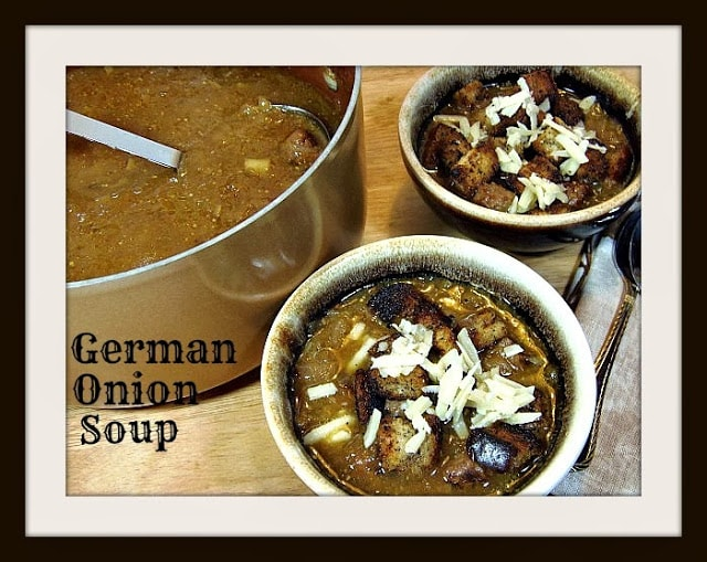 A pot of German onion soup with two smaller brown bowls.