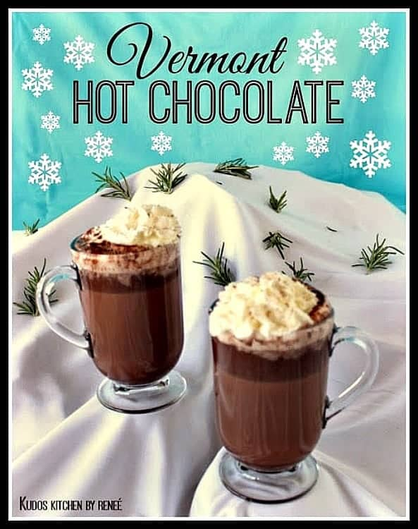 Two cups of Vermont hot chocolate on a snow covered mountain.
