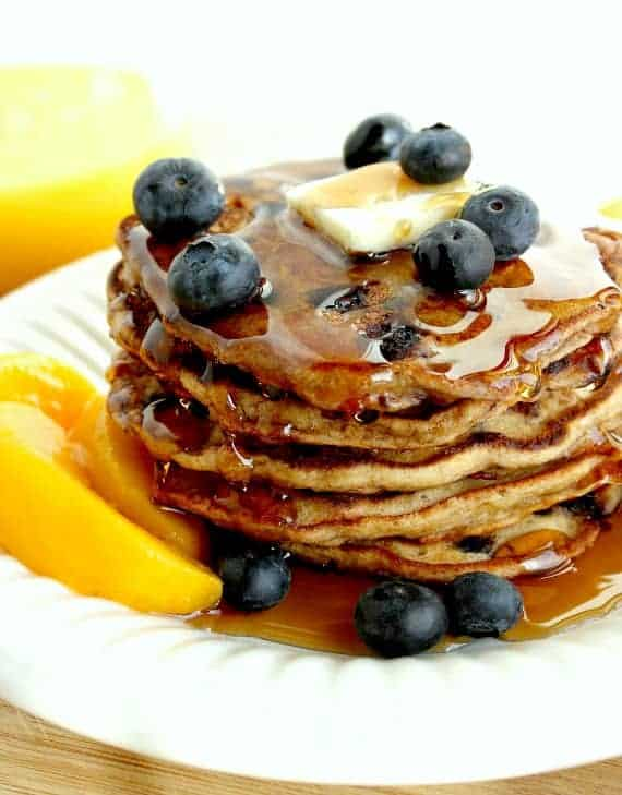 """This recipe for Blueberry Peach Pancakes is one I found (and adapted) from a Cooking Light cookbook called """"Lighten Up America."""" We loved this recipe, and you will too, but you don't have to tell your family they're healthy. That can be our little secret! - kudoskitchenbyrenee.com"""