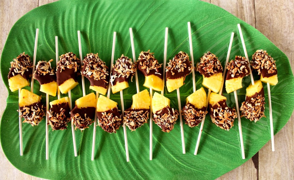Overhead photo of a leaf tray lined with frozen pineapple pops.