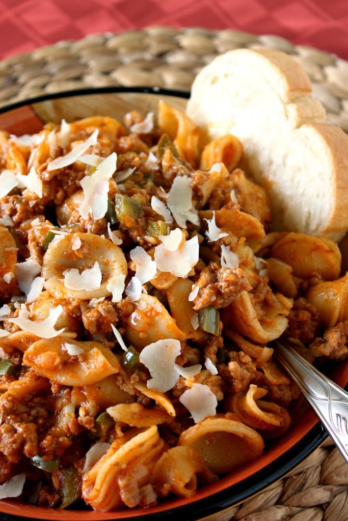 Little ears pasta is mixed with ground pork and lamb meat sauce, green pepper, onion and garlic.