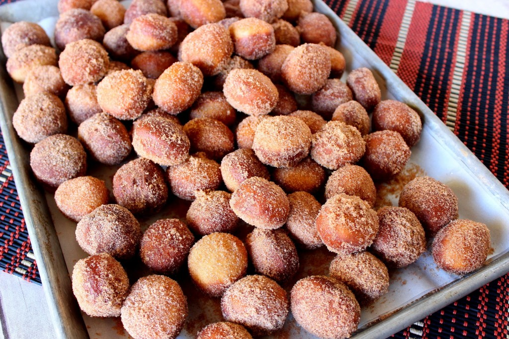 Apple Cider Doughnut Holes are are a seasonal treat that you never outgrow. These soft and pillowy yeasty donuts are dressed to perfection with an irresistible cinnamon sugar topping.