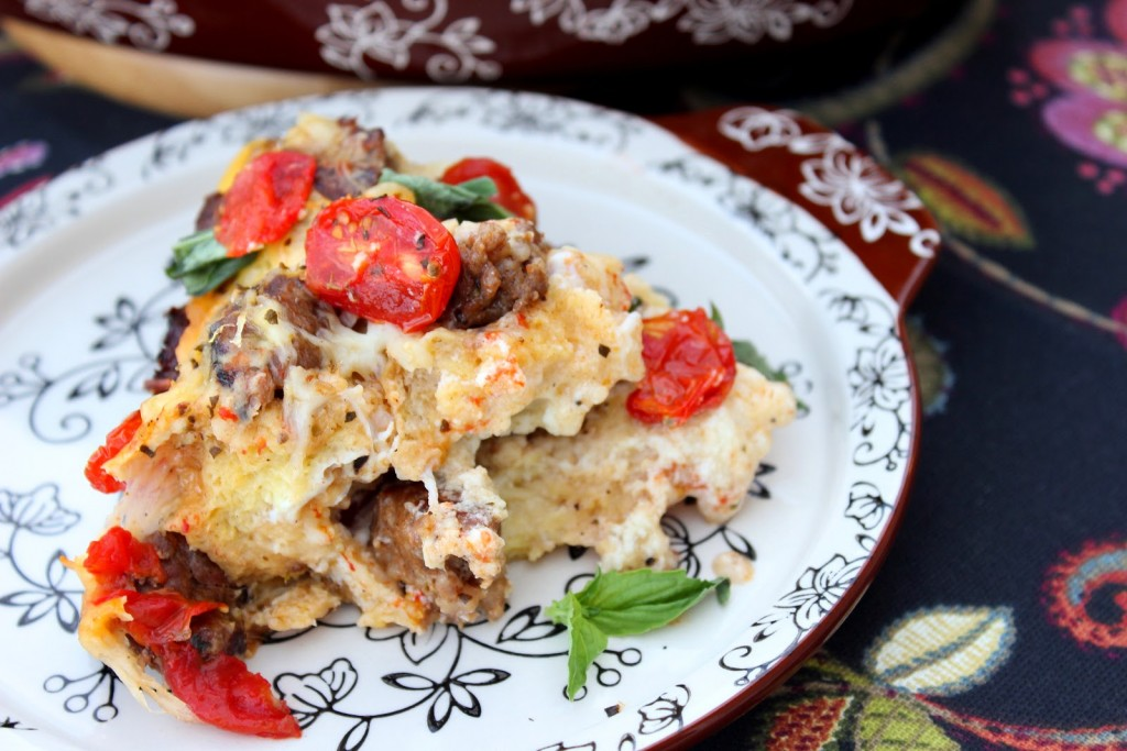 Lasagna Strata. Layers of bread, tomatoes, cheeses, Italian Sausage and eggs combine in this tasty and unique dish inspired by traditional pasta lasagna.