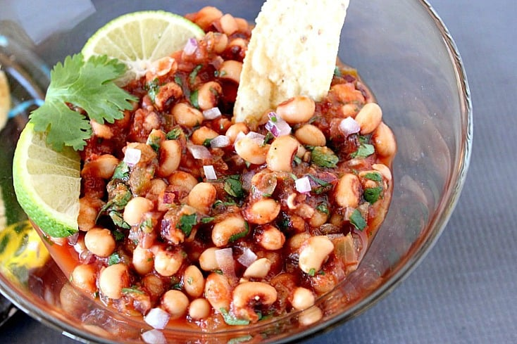 Black Eyed Pea Salsa in a bowl with lime wedges - kudoskitchenbyrenee.com