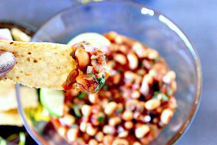 Black Eyed Pea Salsa on a tortilla chip - kudoskitchenbyrenee.com