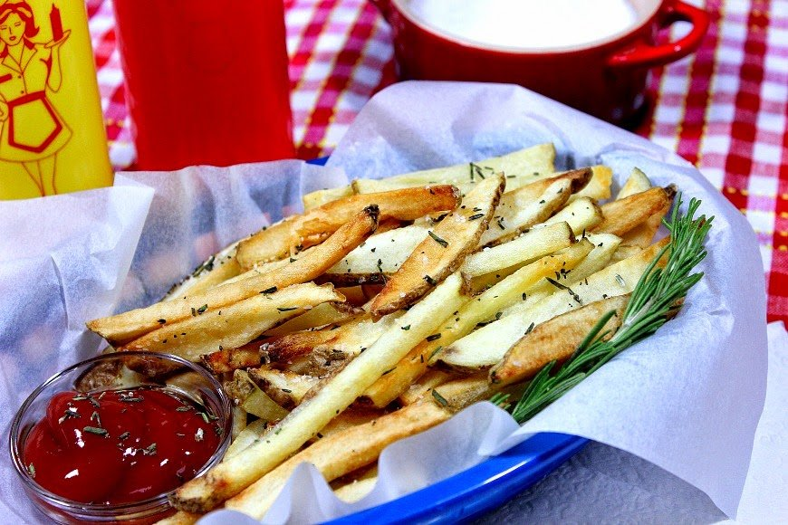 Rosemary French Fries are double fried to make them hot and crispy on the outside, and creamy and soft on the inside.