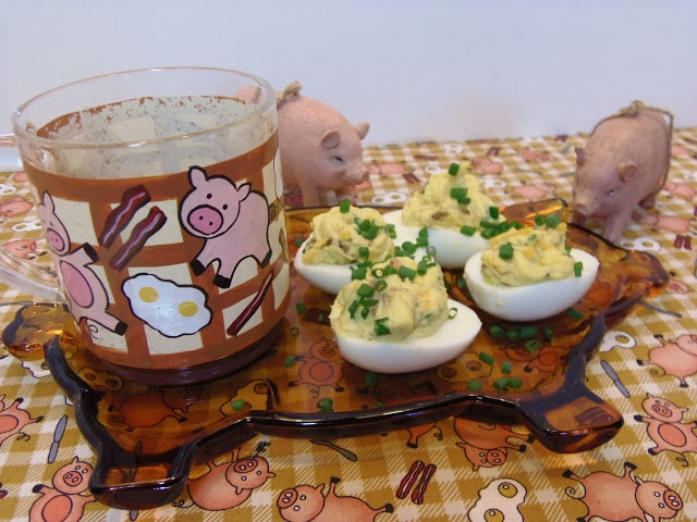 Deviled Eggs on a pig plate the a pig coffee mug.