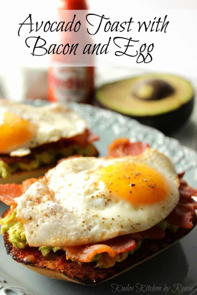 Vertical title text closeup photo of a sunny side up egg on top of Avocado Toast with Bacon.