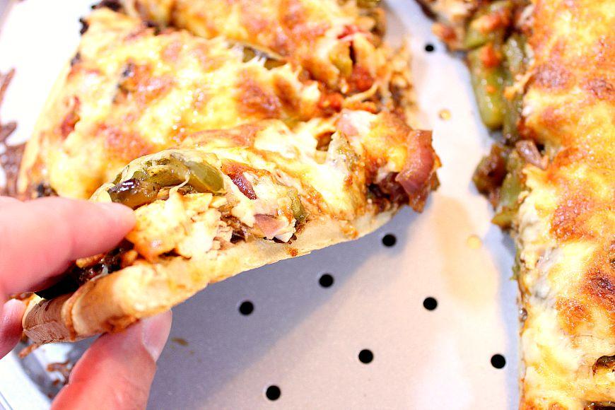 Closeup picture of a slice of Mexican Chicken Fajita Pizza