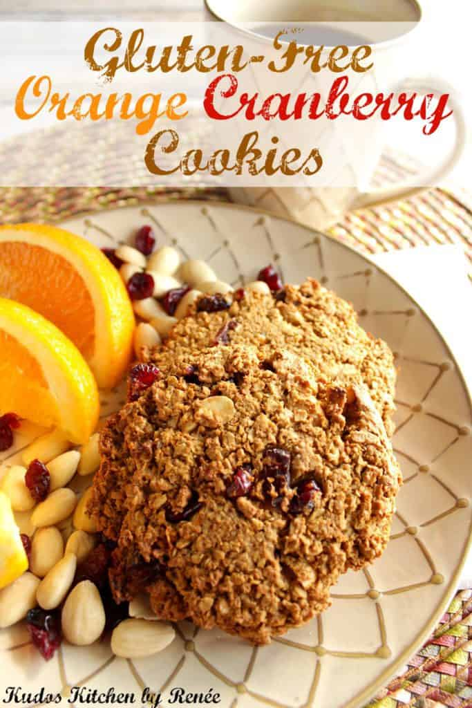 Vertical title text photo of gluten-free breakfast cookies on a plate the oranges and almonds.