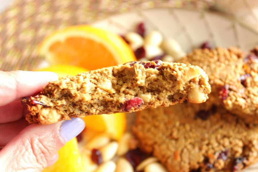 A horizontal photo of the inside of a gluten-free breakfast cookie with almonds and cranberries.