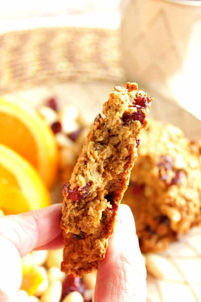 A closeup vertical photo of the inside of a gluten-free breakfast cookie with cranberries and almonds.