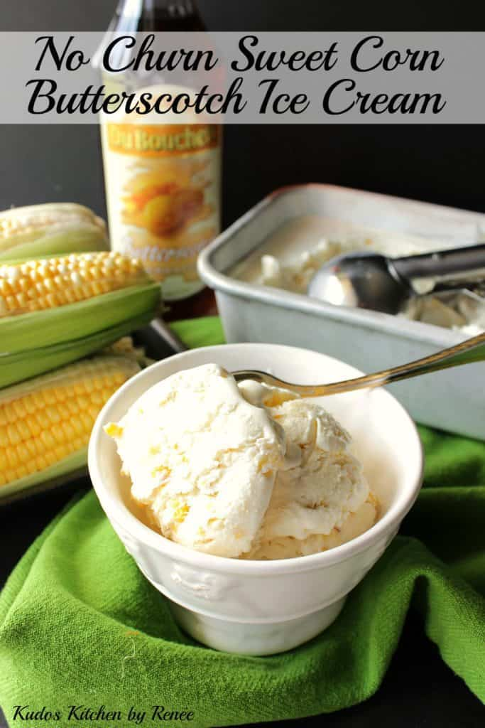 A vertical image of a bowl of no-churn roasted sweet corn ice cream in the foreground and some ears of corn in the background