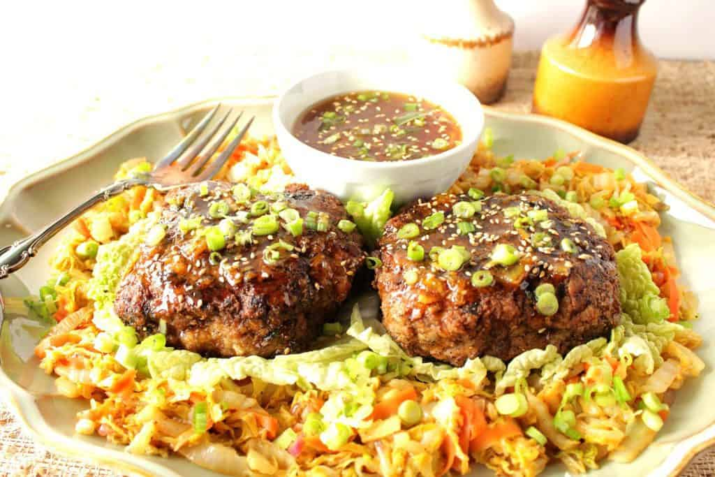 Colorful horizontal photo of two duck burgers on a plate with Asian cabbage with carrots and scallions.