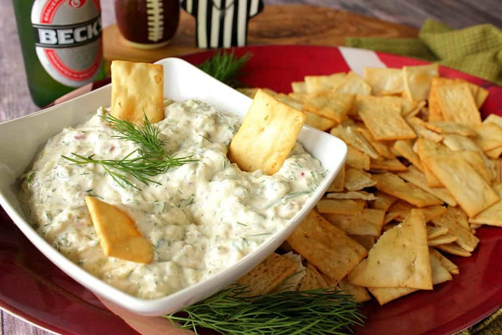 Cucumber Dill Pickle Dip with crackers and fresh dill.