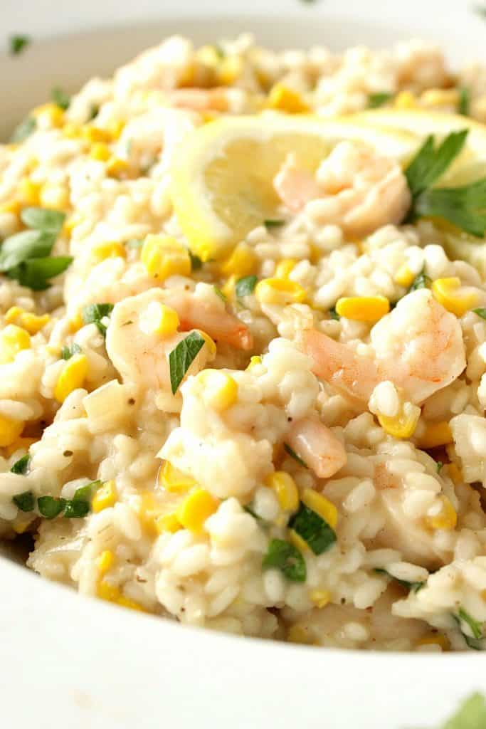 Closeup photo of sweet corn risotto with shrimp.