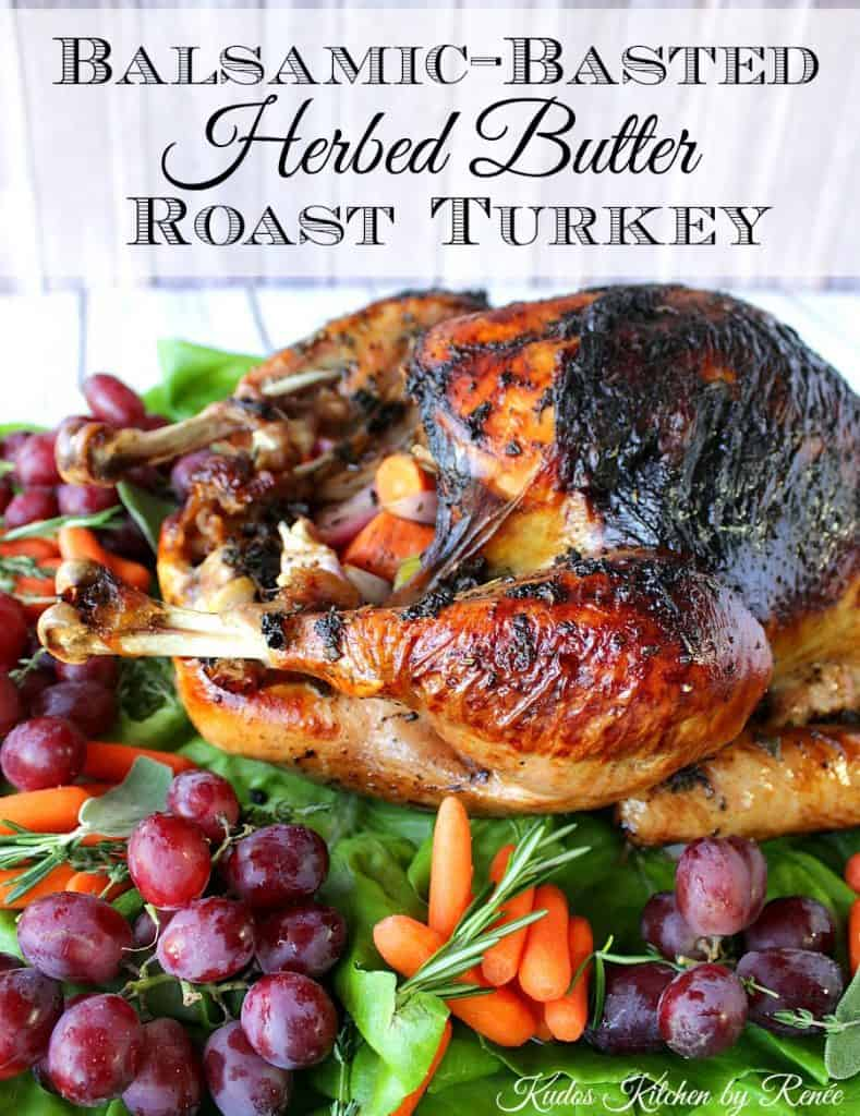 A vertical title text photo of a whole balsamic herb roasted turkey with herbs and vegetables on the platter.