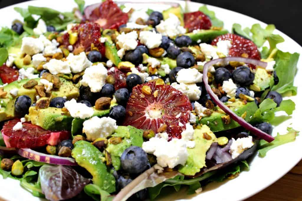 Antioxidant Rich Blood Orange Salad with Blueberries & Feta on a white plate. - kudoskitchenbyrenee.com