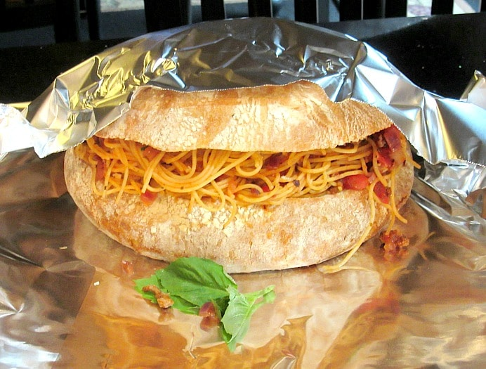 Spaghetti Stuffed Garlic Cheese Bread covered in aluminum foil.
