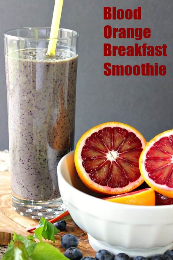 Blood orange smoothie in a glass with title text in upper right hand corner