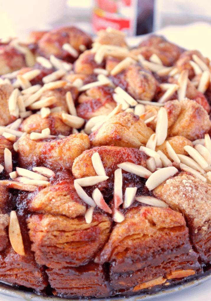 Vertical closeup of monkey bread with raspberry and almonds