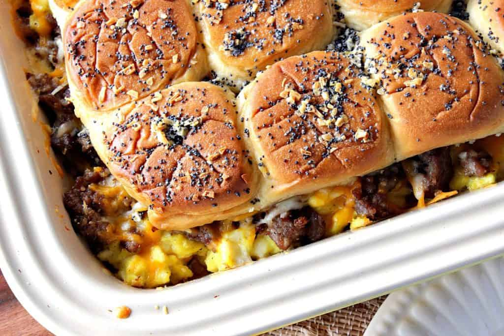 Overhead and closeup image of breakfast sliders with scrambled eggs and sausage