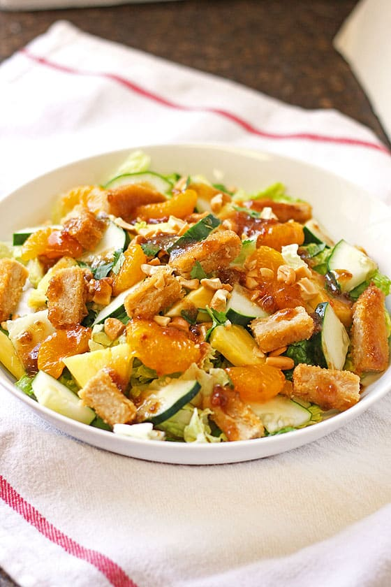 Colorful orange and green salad for healthy salad recipe roundup.