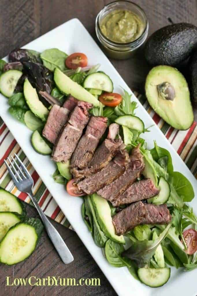 Overhead photo of steak and avocado salad for healthy salad recipe roundup.