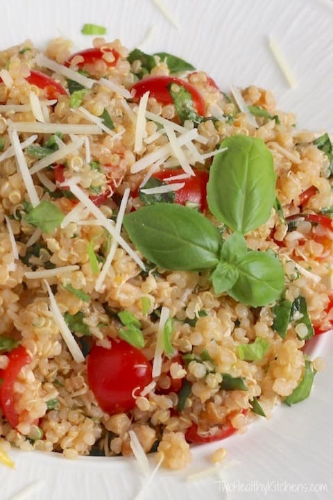 Quinoa salad photo with basil for healthy salad recipe roundup.