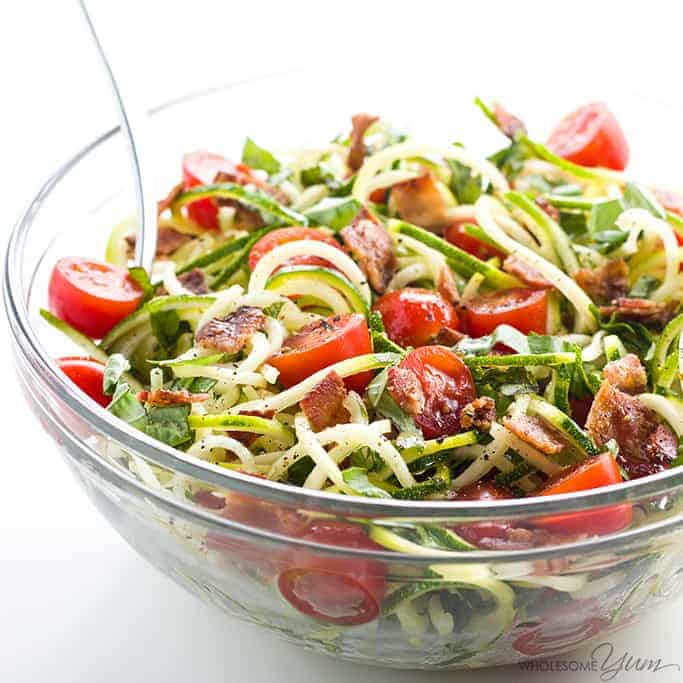 Zoodle salad with tomatoes for healthy salad recipe roundup.