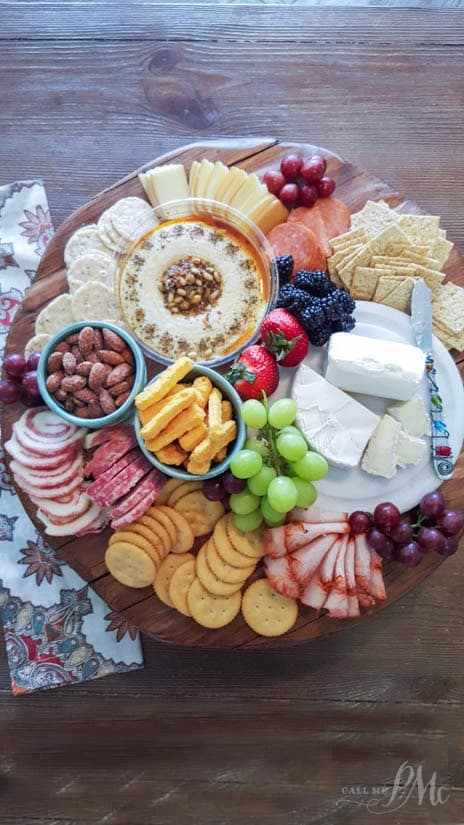 Overhead photo of a meat and cheese platter. New Year's eve appetizers and drinks recipe roundup.