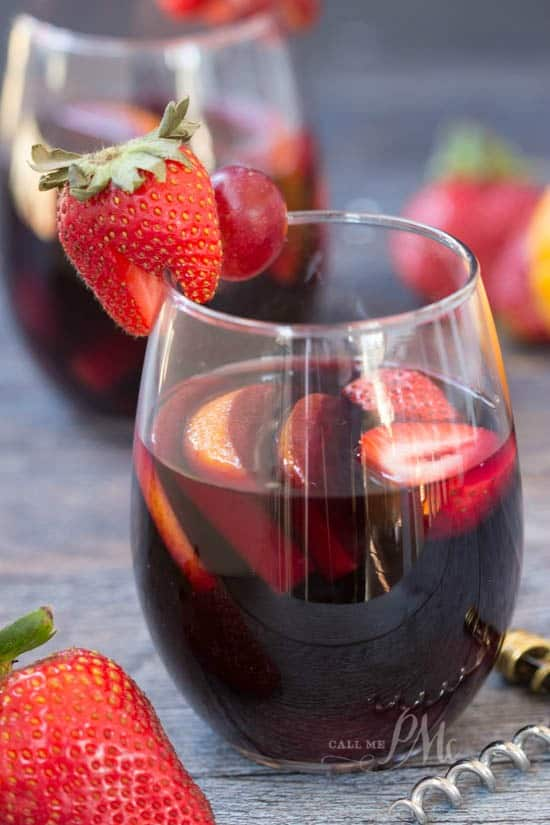 Closeup photo of sangria with strawberries. New Year's eve appetizers and drinks recipe roundup.