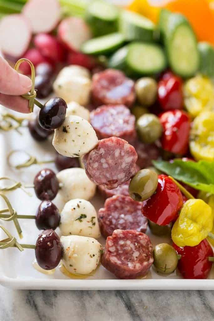 Colorful closeup of a antipasti skewer. New Years eve appetizers and drinks recipe roundup.