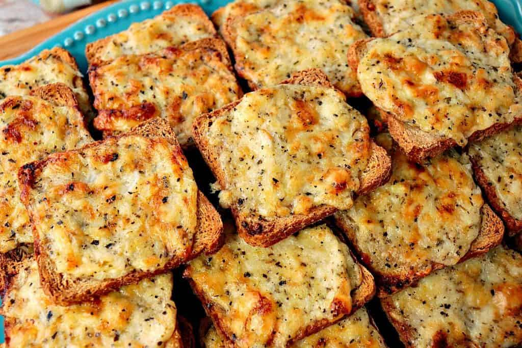 Closeup photo of golden Parmesan Onion Appetizer Squares