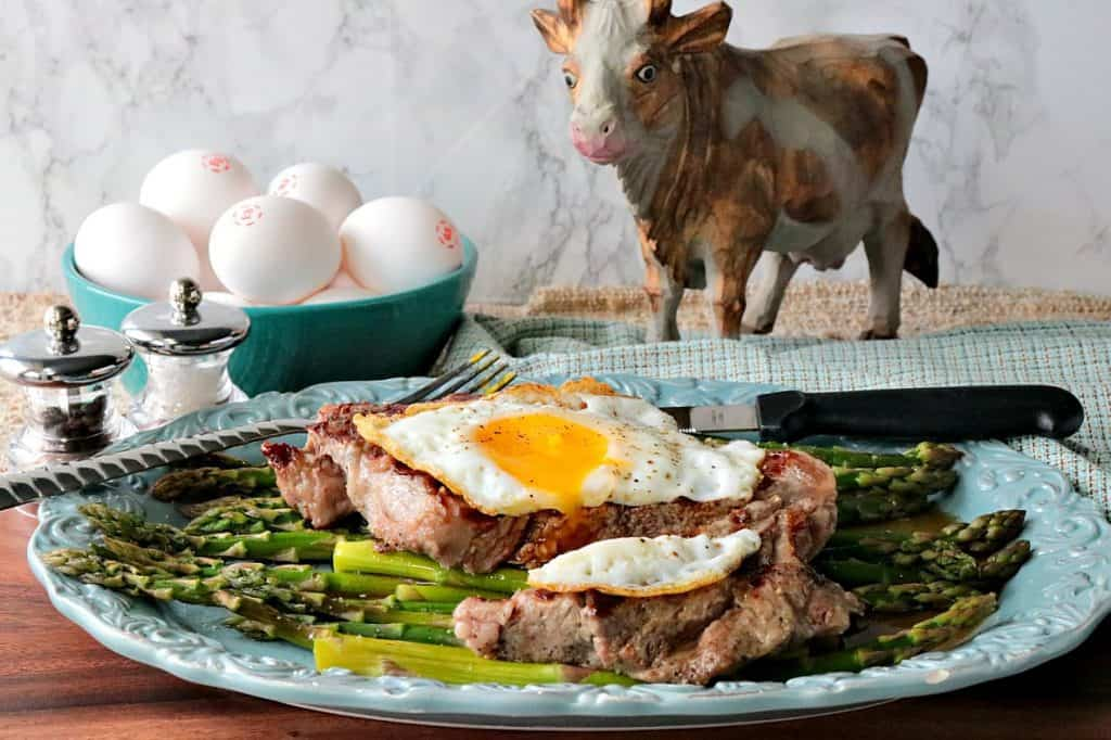 Buttery Rich Keto Steak and Eggs Over Asparagus - www.kudoskitchenbyrenee.com