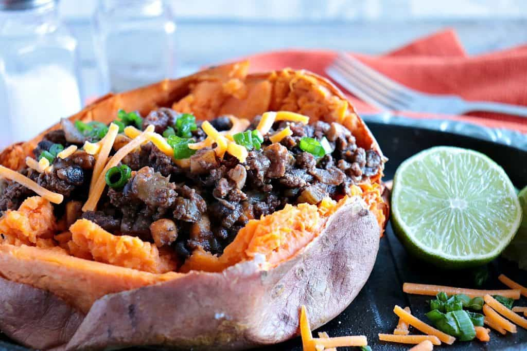 Closeup image of Tex-Mex Stuffed Sweet Potatoes  with cheese and scallions