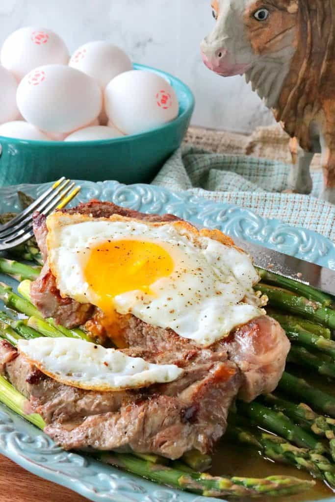 Buttery Rich Steak and Eggs Over Asparagus - www.kudoskitchenbyrenee.com
