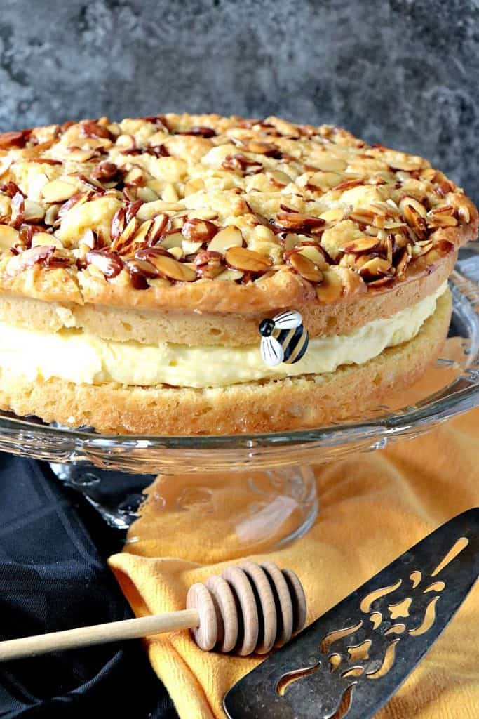 Vertical closeup photo of a German bee sting cake with honey almonds and cream filling.