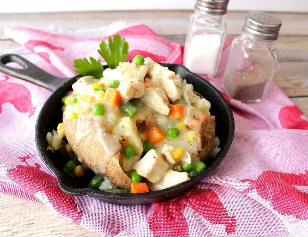 Easy Weeknight Dinner Recipes of a chicken pot pie potato in a cast iron skiller.