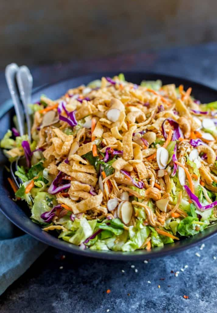 Easy Weeknight Dinner Recipes. Colorful salad in a black bowl with almonds and a crunchy topping.