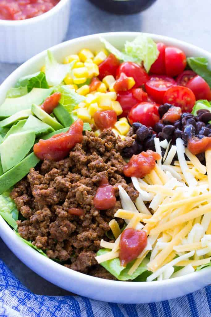Easy Weeknight Dinner Recipes. Colorful taco salad in a white bowl.