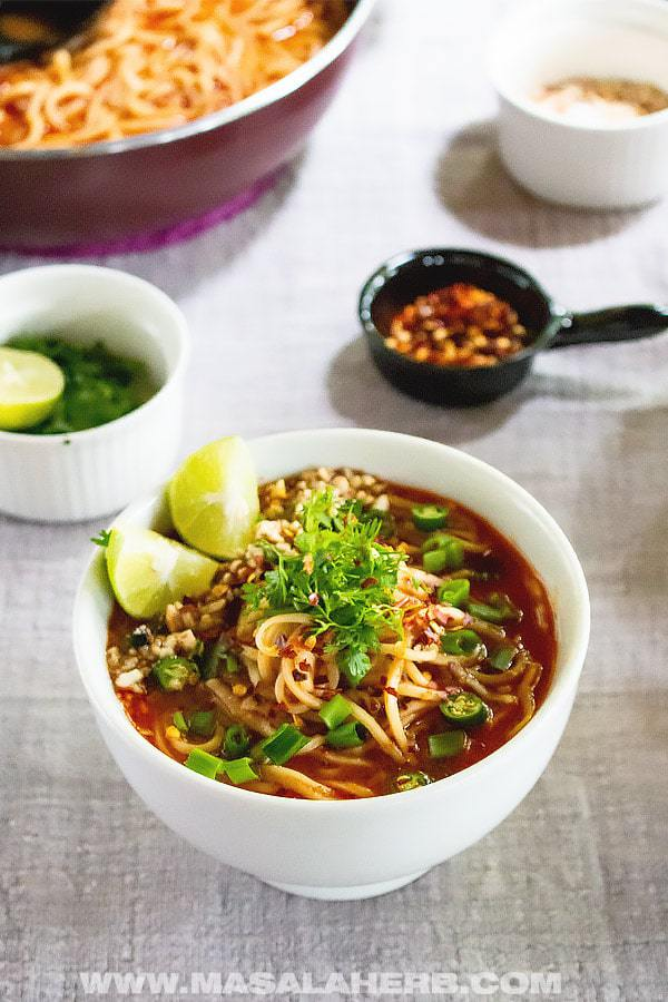 Easy Weeknight Dinner Recipes. Small white bowl of Asian noodles and sauce with lime and scallions.