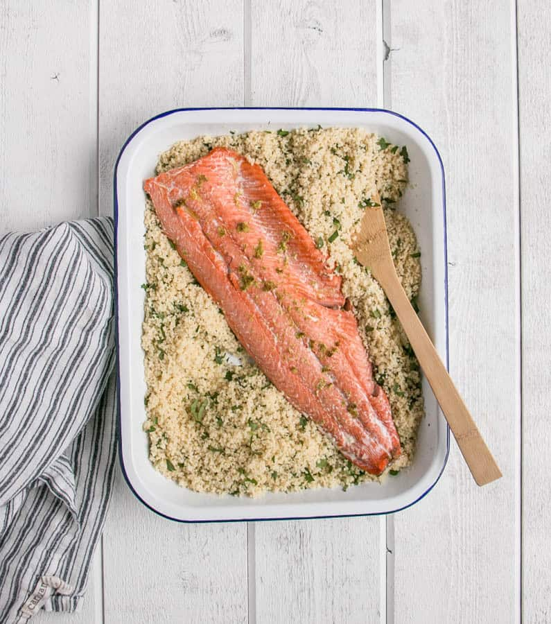 Easy Weeknight Dinner Recipes. A salmon fillet in a casserole dish with couscous.