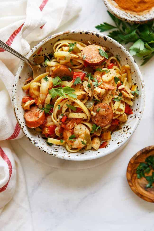 Easy Weeknight Dinner Recipes. Overhead photo of a bowl of noodles with sausage and shrimp.