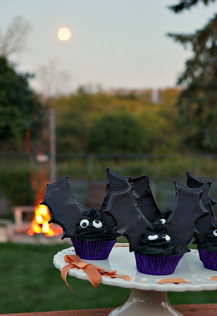 Bat wing cupcakes with a fire and a full moon. Halloween recipe roundup