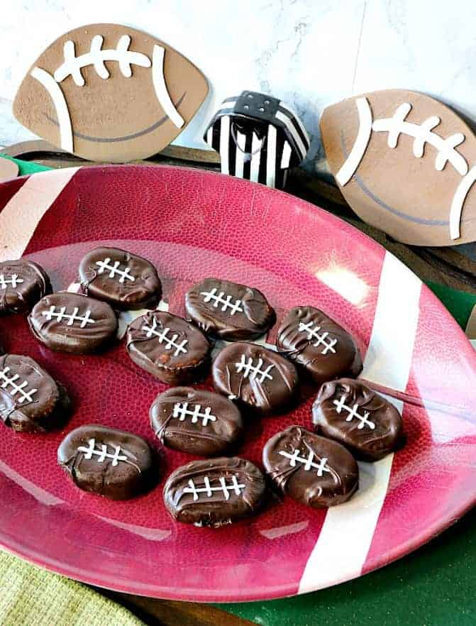 On overhead photo of a tray of chocolate covered football crackers.