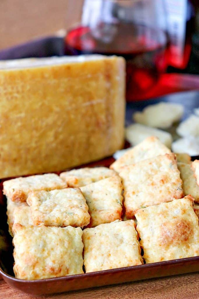 Vertical closeup image of Parmesan fennel crackers. Thanksgiving and fall appetizer recipe roundup.