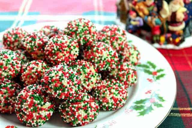 A plate of cream cheese Christmas sprinkle cookies for a Colossal Christmas Cookie Recipe Roundup.