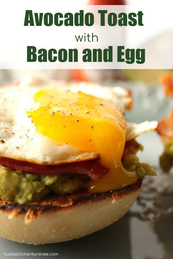 Closeup picture of a runny egg on top of avocado toast with bacon